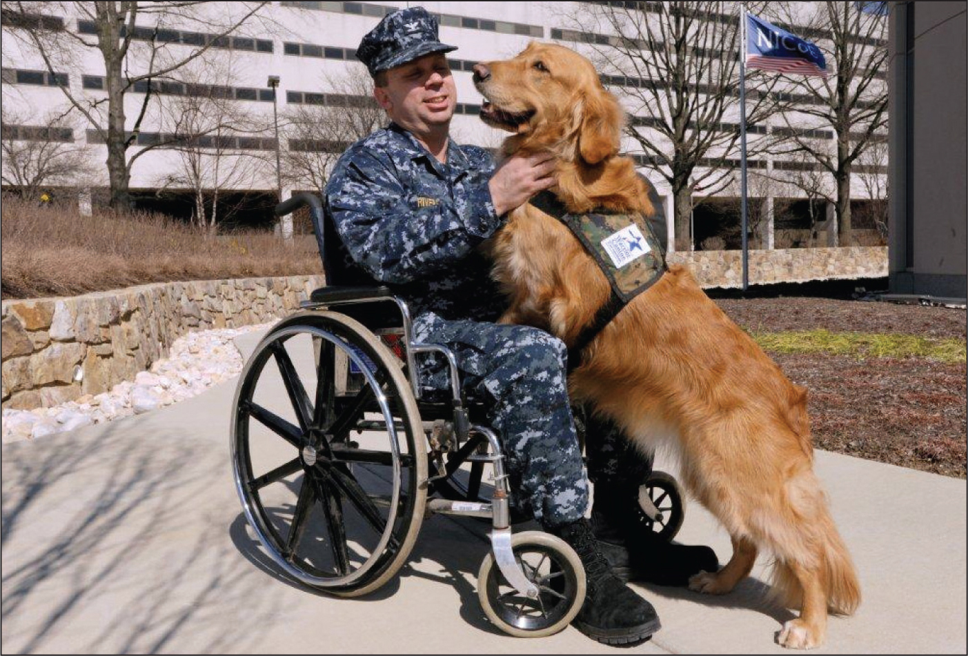 Valerie, a golden retriever, demonstrates her ability to connect with a Marine at the National Intrepid Center of Excellence.Image courtesy of Rick Yount, MS, LSW.