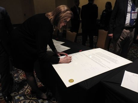 Carol Alexander, OD, head, North America professional relations, Johnson & Johnson Vision Care, adds her name to the proclamation.