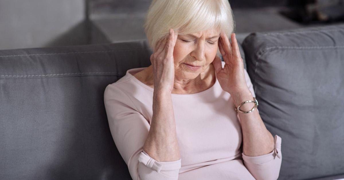 older woman with headache adobe.