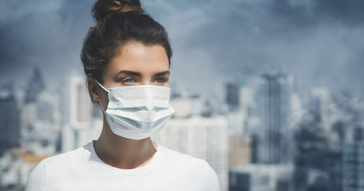Amid Air Pollution, a Woman Wears a Mask