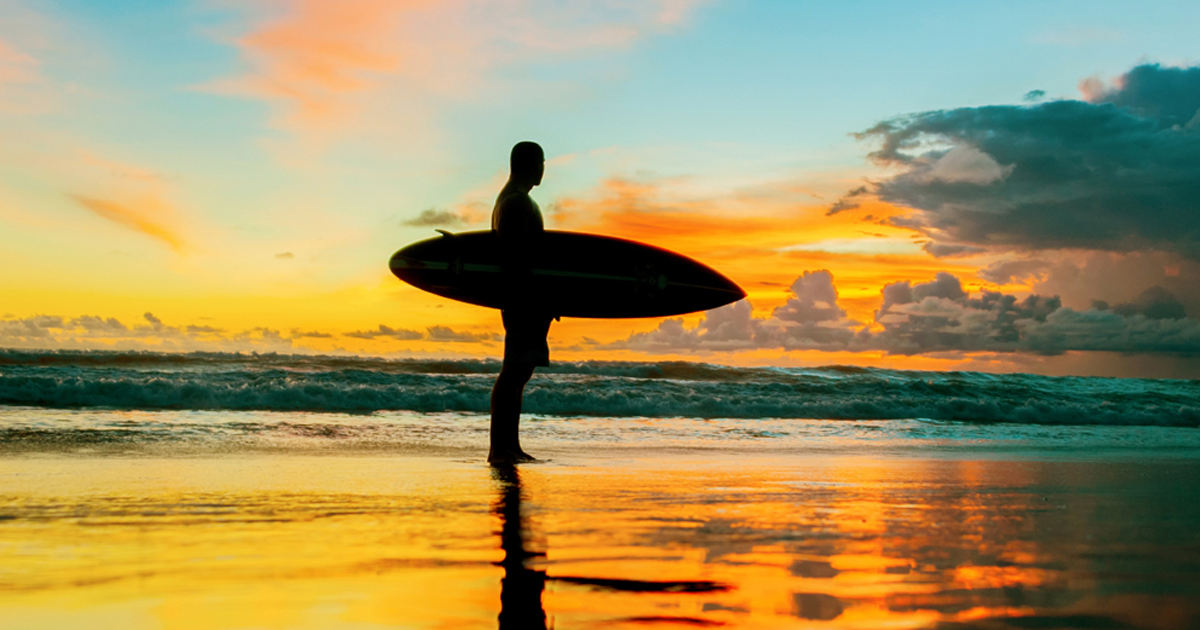 Photo of surfer during sunset